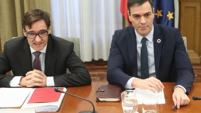 Salvador Illa junto a Pedro Sánchez